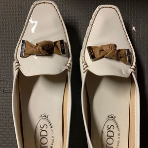 Brand new Tod's patent leather loafers with bow